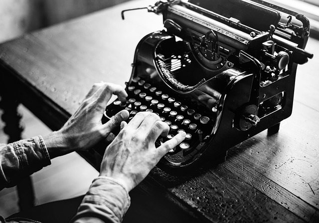 a man sitting down at a typewriter ready to tell a story