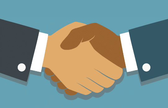 two long term customers shaking hands